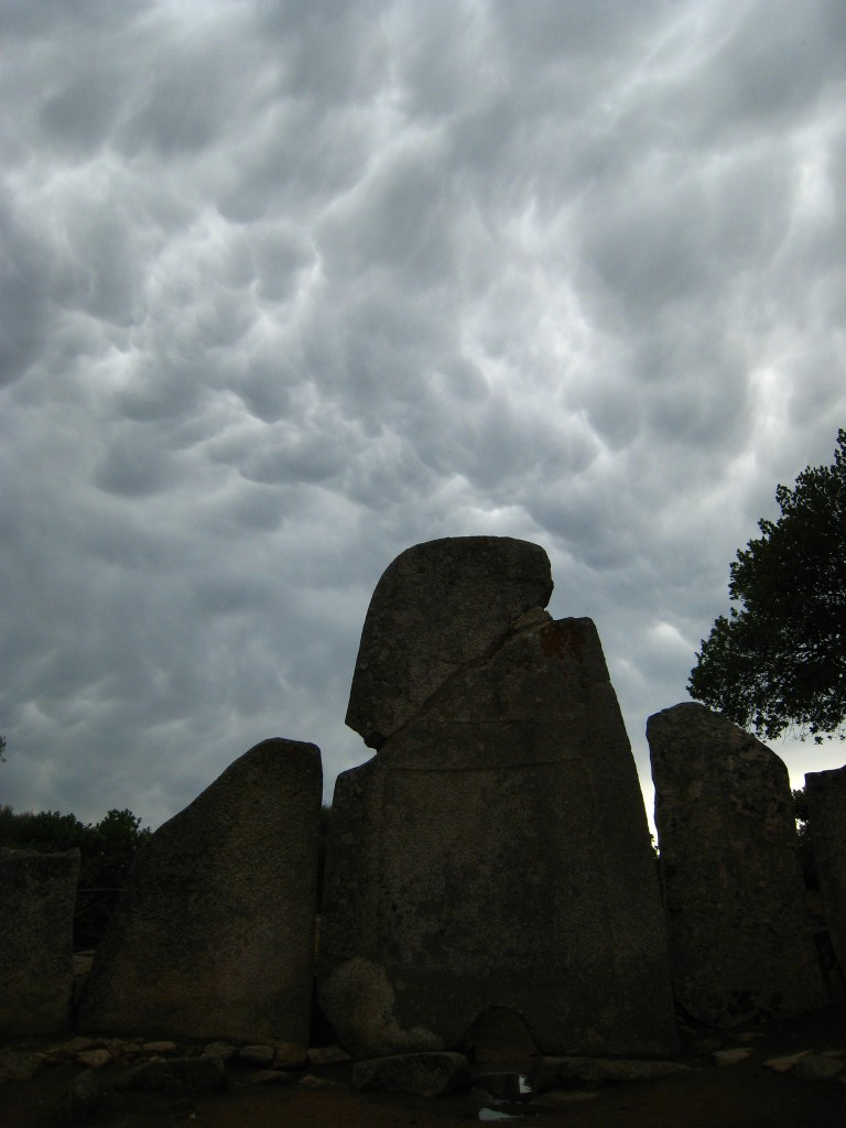 The central stone at the Li Longhi grave site, under a balmy mediterranean sky